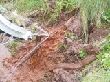 Heavy iron deposits being flushed from old land drain