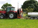Drain flusher mounted on tractor with 1300 litre bowser